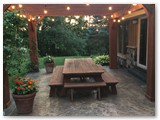 Seating-area-with-lights-and-pergola-stamped-patio-extra-large-custom-table